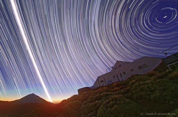 In a long exposure from the Canary Islands, sun and stars streak the sky on the 2011 vernal equinox. Photo: Juan Carlos Casado, TWAN